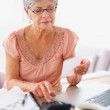Royalty-Free Stock Photo: Senior woman calculating her monthly bills