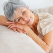 Day dreaming - Closeup of a senior woman relaxing on a couch - Foto Stock