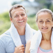 Relaxed man and woman after a gym workout - Stock Photo