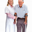 Nurse helping a patient on crutches against white background - Stock Photo