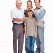 Happy family of four standing together against white - 