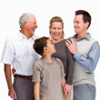 Happy family of four smiling together against white - Stockfoto