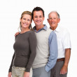 Mature couple standing with a senior man in line against white - Stock Photo