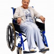 Happy older woman sitting isolated on wheelchair - Stock Photo