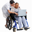 Nurse teaching a senior woman to use laptop against white - Stock Photo