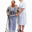 Royalty-Free Stock Photo: Nurse helping an old woman with a walking frame