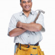 Royalty-Free Stock Photo: Middle aged handyman wearing a tool belt with hammer in hand