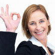 Beautiful mature business woman gesturing an excellent job over - Stock Photo