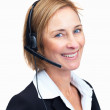 Confident mature customer service operator with headset - Stock Photo