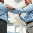 Royalty-Free Stock Photo: Senior business man congratulating his colleague