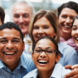 Successful diverse business team laughing together - Stock Photo
