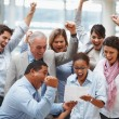Royalty-Free Stock Photo: Business team celebrating over finalization of a contract