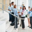 Business in a group at the staircase - Stock Photo