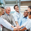 Diverse group of business team with hands together - teamwork - Stock Photo
