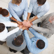 Business with their hands together in a circle - Stock Photo