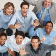 Top view of happy business team celebrating success - Stockfoto