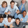 Top view of happy business team celebrating success - Stock Photo