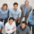 Royalty-Free Stock Photo: Top view of happy business colleagues standing in a group