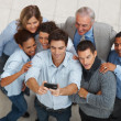 Diverse business posing for a self team photograph - Stock Photo