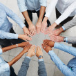 Top view of a business team taking an oath in a circle - Stock Photo