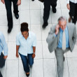 Royalty-Free Stock Photo: Top view of business executives walking on tiled floor