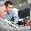 Royalty-Free Stock Photo: Business men reading the financial newspaper
