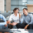 Happy group of business having a casual talk - Stock Photo