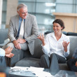 Business enjoying a casual talk at the office lounge - Foto de Stock  
