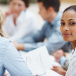 Black business woman in a meeting with associates - Stock Photo