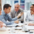 Young man presenting his ideas to his business team - Foto Stock