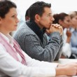 Business executives attending a seminar - paying attention - Stock Photo