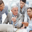 Senior business manager discussing work with his colleagues - Stockfoto