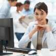 Pretty Caucasian business woman at office desk - Stok fotoraf
