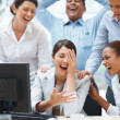 Royalty-Free Stock Photo: Business colleagues laughing at a funny email on the computer