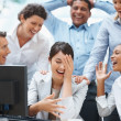 Colleagues enjoying a laugh on a funny email - Foto Stock
