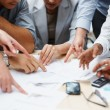 Teamwork - Business hands working with documents - Stock Photo