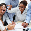 Smiling business working together at a meeting - Stock Photo