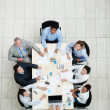 Business colleagues sitting together for meeting - Stock Photo
