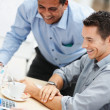 Happy business men having a good time at work - Stockfoto