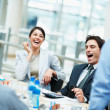 Royalty-Free Stock Photo: Business having a good laugh during the meeting