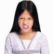 Little girl expressing anger on white background - Stock Photo