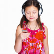 Royalty-Free Stock Photo: Little healthy girl with headphones and MP3 player