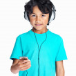 Royalty-Free Stock Photo: Young boy listening to music with headphones and MP3 player