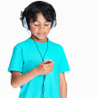 Royalty-Free Stock Photo: Boy listening to music with headphones and MP3 player