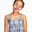 Little black girl making a funny face on white background - Stock Photo