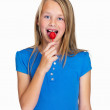 Happy little girl enjoying a lollipop on white - Stock Photo