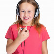 Royalty-Free Stock Photo: Cute little girl hearing music over headphones