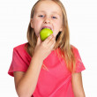 Royalty-Free Stock Photo: Adorable Caucasian girl eating a green apple