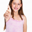 Happy girl gesturing a success sign against white - Stock Photo