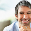 Closeup of a charming mature man smiling with copyspace - Стоковая фотография